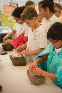 kids grinding corn